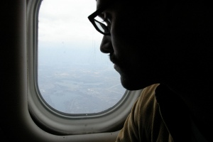 Traveler looking out the window of an airplane