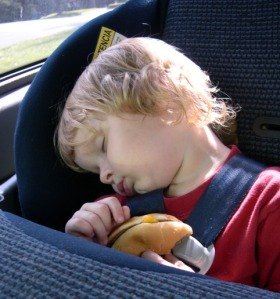 Kid in a Car Seat with Cheeseburger